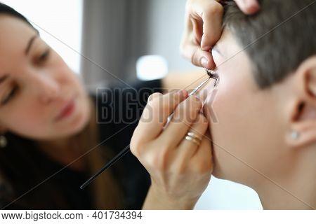 Close-up Of Visagist Using Professional Cosmetics. Make-up Artist Doing Makeup To Woman. Visagiste M