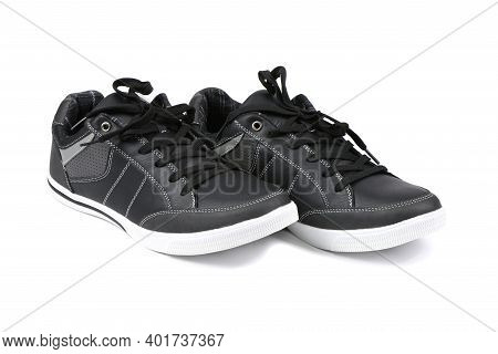 Pair Of Black Women Sneakers Isolated On White Background. High Resolution Photo. Full Depth Of Fiel