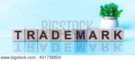 Trademark - Text On Wooden Cubes On A Blue Gradient Background. Word Trademark Is Written In Black L