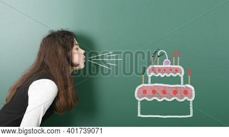 Pre-adolescent Girl Blowing On Candle Fire Painted Beautiful Cake. Portrait Photo On School Board Ba