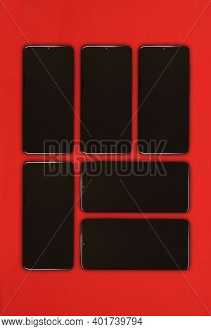 Black Mobile Smartphone With Blank Screen. Isolated On Red Background. High Resolution Photo. Full D