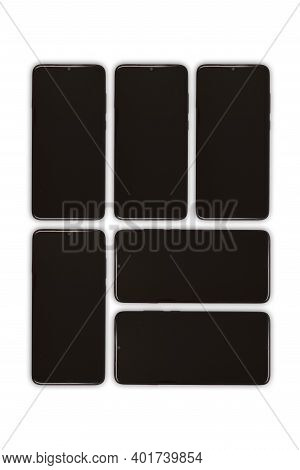 Black Mobile Smartphone With Blank Screen. Isolated On White Background. High Resolution Photo. Full