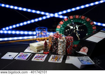 Casino set with Roulette, cards, dice and chips on BlackJack mat