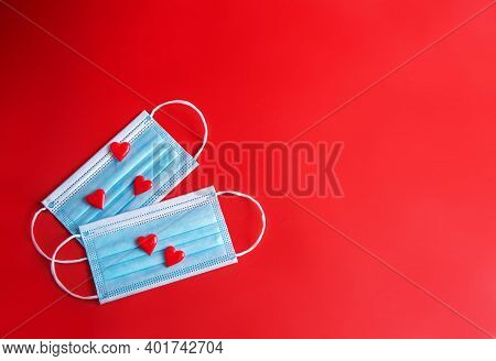 Red Background With Red Hearts For Valentine's Day And Blue Mask