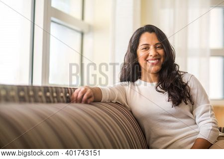 Portrait Of A Hispanic Woman At Home.