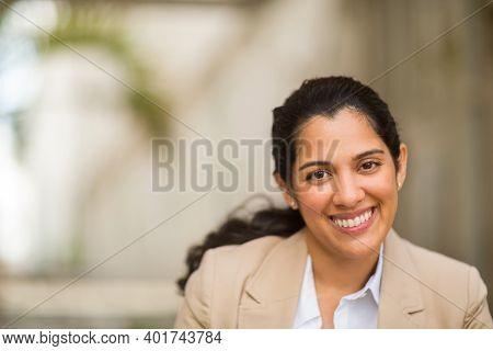 Hispanic Business Woman Smiling Outside Stock Photo