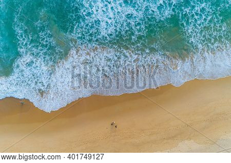 Amazing View Aerial View Drone Camera Photo Of Waves Crashing On Sandy Shore,top View Of Beautiful S