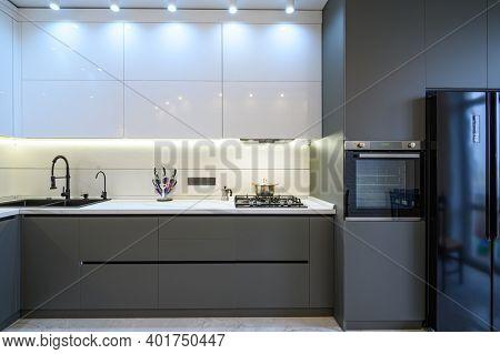 Luxury grey modern kitchen interior. front view