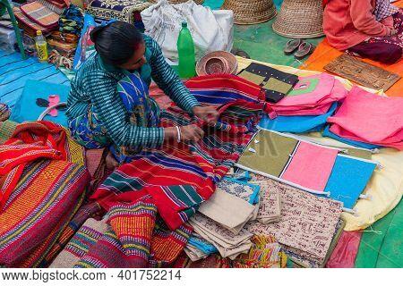 Kolkata, West Bengal, India - 31st December 2018 : Young Bengali Woman Selling Carpets, Door Mats, H