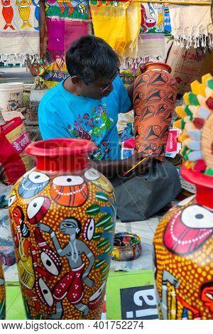 Kolkata, West Bengal, India - 31st December 2018 : Young Bengali Artist Man Painting Colors On Terra
