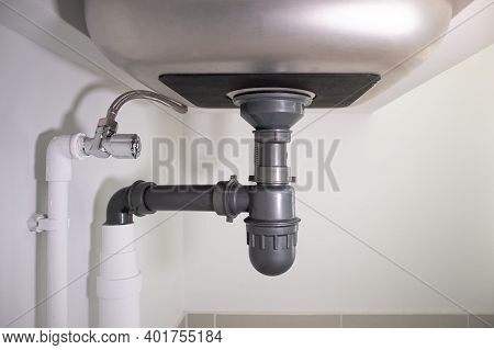 Pipe Under Kitchen Sink. For Water Or Sewer Drain, Siphon, Repair And Maintenance.
