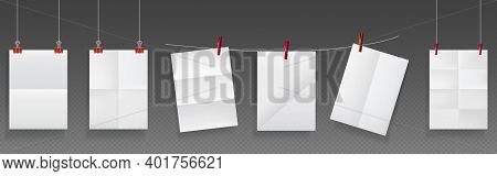 Folded Posters Hang On Rope And Pins, White Paper Blank Sheets Of Wrinkled Texture. Mockup For Flyer