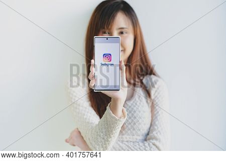Chiang Mai, Thailand - Dec 13, 2020 : A Woman Hand Holding Samsung Note 10 Plus With Login Screen Of