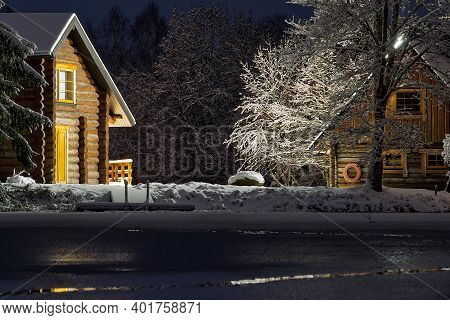 Wooden Log Cabin At Winter Night. Country House In Winter Evening Can Be Used As Postcard, Wallpaper