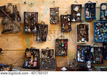Aged Wall With Different Antiques On Flea Market Or Festival - Vintage Silver Cultery - Spoons, Knif