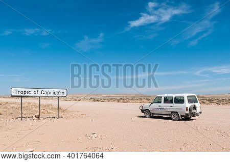 Khomas Region, Namibia - June 22, 2012: The Tropic Of Capricorn Sign Board On Road C14. A Vehicle Is