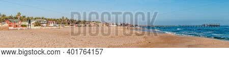 Swakopmund, Namibia - June 18, 2012: A Panoramic Beach Scene, With The Historic Jetty From The Germa