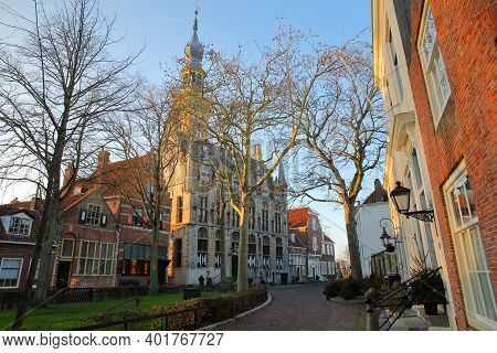 The Main Square (markt) With Traditional Medieval Houses And The Stadhuis (town Hall) With Its Impre