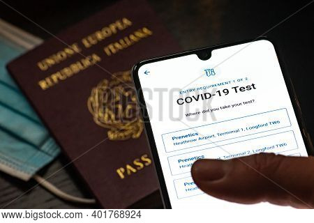 Rome, Italy, - January 4 2020: Vaccine Passport App Displayed An A Smartphone, With Passport Or Visa
