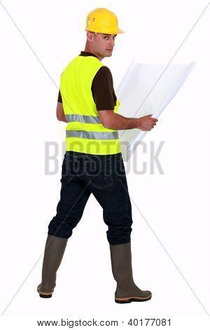 Tradesman looking at a blueprint