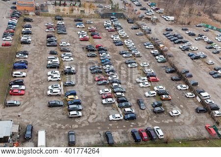 City Outdoor Fenced Parking Lot With Semi-durable Surface In Cloudy Weather, Top View