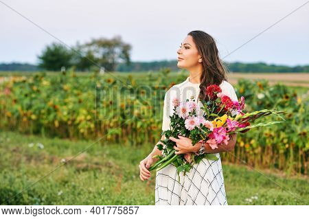 Outdoor Portrait Of Beautiful And Happy Woman Holding Bouquet Of Colorful Flowers, Nature Lifestyle