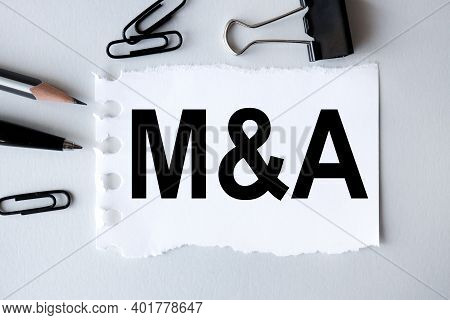 Mergers And Acquisitions, . Text On White Notepad Paper On Gray Background. Business Concept. View F
