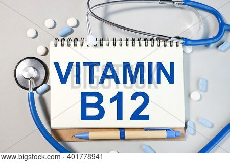 Vitamin B12, Text On White Gray Background On White Notepad Paper. Medicine Concept.