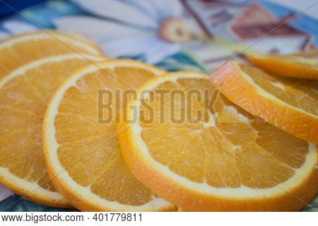 Orange Fruit Slice Isolated On Yellow Background. Close-up Of Fresh Orange Slice Over Orange Backgro