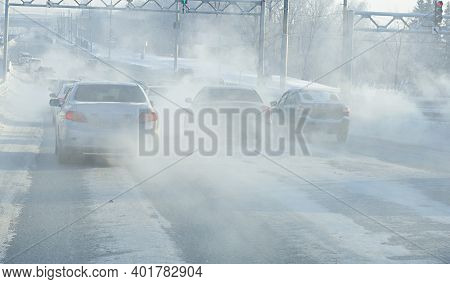 Air Pollution From Exhaust Fumes From Cars In The City, On A Cold Day, Air Pollution In Cities