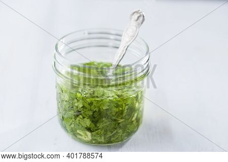 Close Up Of A Bottle Of Green Chimichurri Meat Sauce
