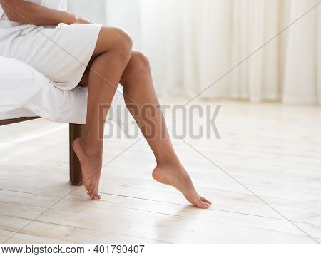 Hair Removal, Body Care And Female Beauty. Beautiful Slender Legs Of Young African American Lady In