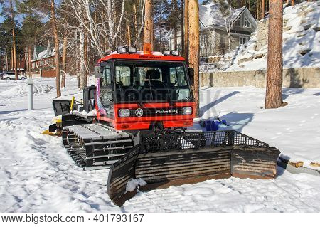Miass, Russia - February 9, 2020: Snow Groomer Pistenbully Pb 160 With A Tiller And Tracksetter In A