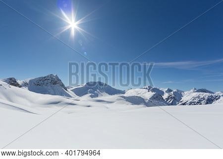 Untouched Winter Landscape With Snowy Mountains In Schanfigg