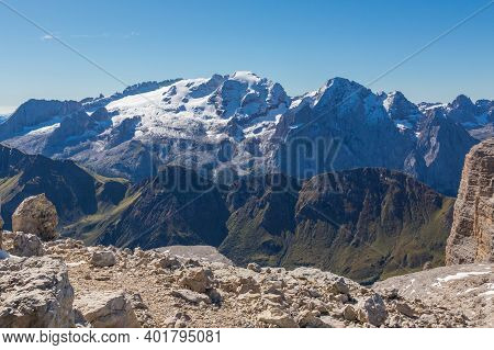 Glacier Of Unesco World Heritage Marmolada Mountain With Blue Sky