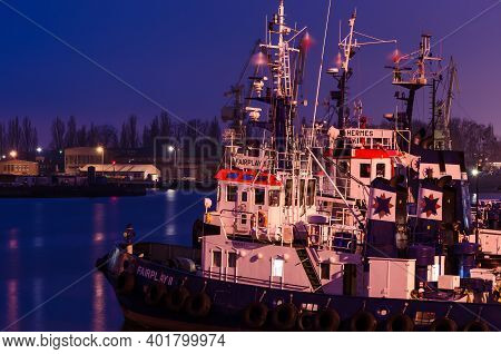 Szczecin, West Pomeranian - Poland - 2020: Tugboats Are Moored At The Quays Of The Seaport