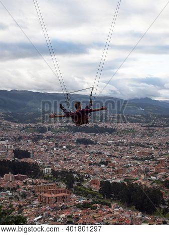 Tourist Adventurer On Panorama Swing Columpio Extreme Sports At Mirador Turi Viewpoint Flying Above