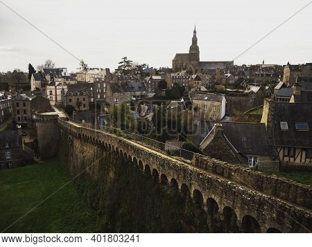 Panorama Of Ancient Historic Stone House Buildings City Wall Bridge In Village Town Dinan In Brittan