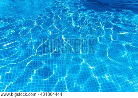 Blue Background Of Water Surface In Above Ground Swiming Pool.