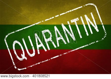 The Stamp Quarantin On The Background Of The Flag Of Lithuania. Quarantine During The Covid-19 Coron