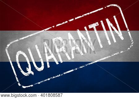 The Stamp Quarantin On The Background Of The Flag Of The Netherlands. Quarantine During The Covid-19