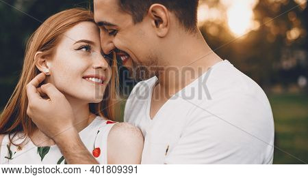 Ginger Caucasian Lady With Freckles And Her Lover Cheering Outside In The Park Embracing And Smile F