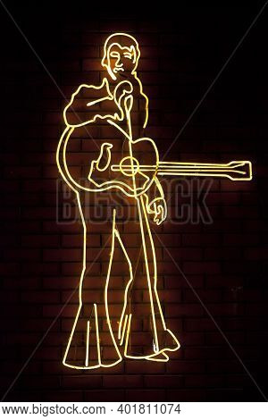 Los Angeles - September 28 2013: Close-up On A Yellow Neon Light Shaped Into Elvis Presley Singing I