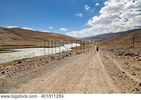 Pamir Highway M41 International Roa Or Pamirskij Trakt. Panj River And Pamir Mountains. Panj Is Uppe