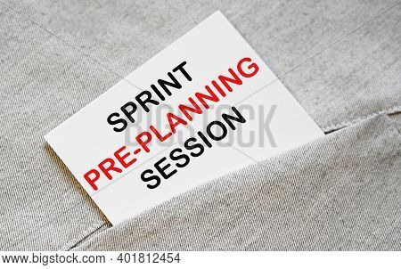 Sprint Pre-planning Session Text On The White Sticker In The Shirt Pocket.