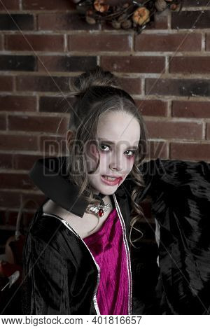 A Beautiful Woman, A Vampire. Halloween Beauty, Makeup And Jewelry, A Girl In A Vampire Costume On T