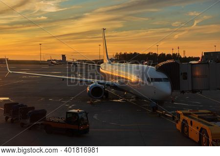 The Concept Of An Emotional Journey Around The World During Covid 19. The Plane At The Terminal Is P