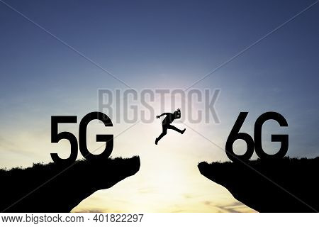 Technology Transformation Change  From 5g To 6g , Silhouette Businessman Jumping From 5g Cliff To 6g
