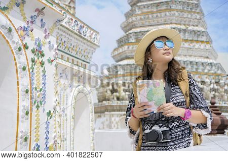 Woman Tourist Is Traveling And Sightseeing Inside Wat Arun On The Chao Phraya River In Bangkok Thail