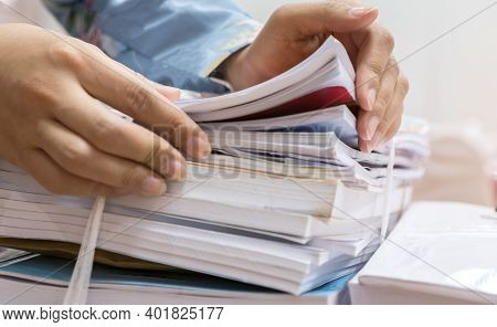 Businesswoman Working In Stacks Of Paperwork Files For Searching Infomation Unfinished Documents Abo